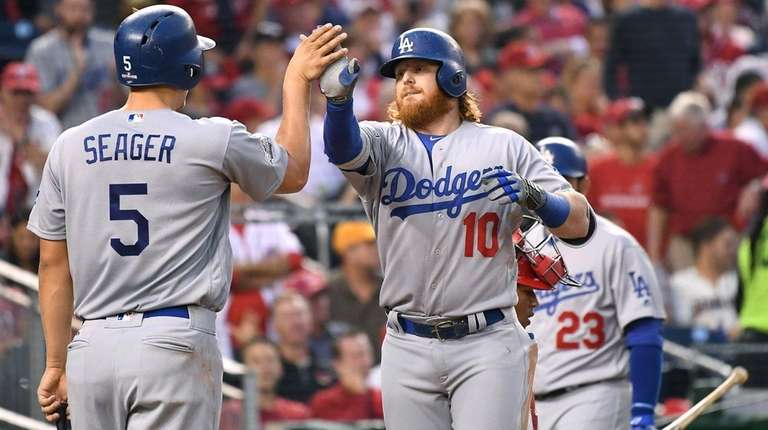 The Los Angeles Dodgers' Justin Turner celebrates his