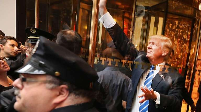 Donald Trump greets supporters outside Trump Tower in