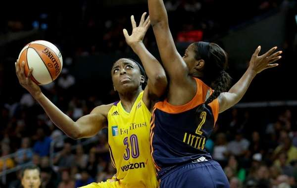 Los Angeles Sparks forward Nneka Ogwumike, left, shoots