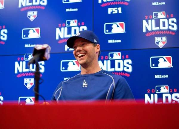 Los Angeles Dodgers' pitcher Rich Hill smiles before