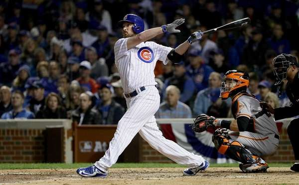 Travis Wood of the Chicago Cubs hits a