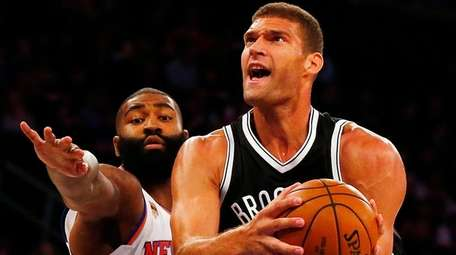 Brook Lopez of the Brooklyn Nets goes to