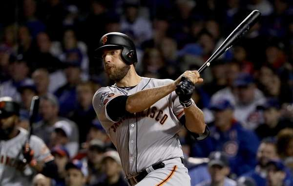 Madison Bumgarner of the San Francisco Giants reaches