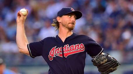 Cleveland Indians starting pitcher Josh Tomlin delivers pitch