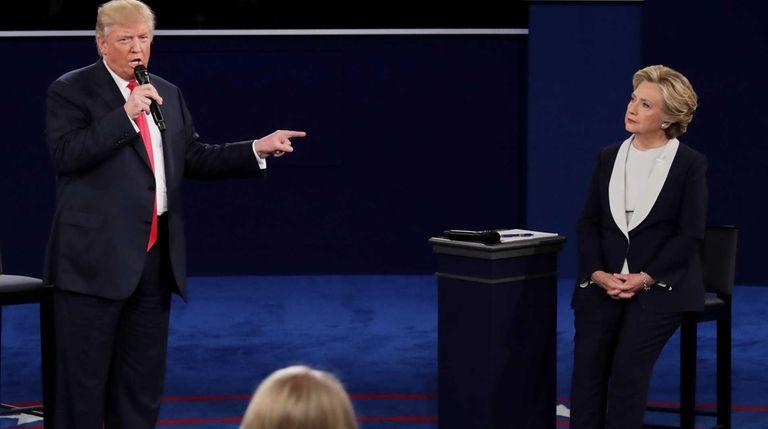 Republican presidential nominee Donald Trump points at Democratic