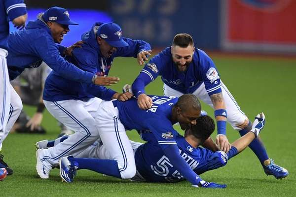 Toronto Blue Jays players mob Russell Martin (bottom)