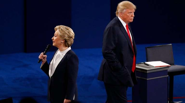 Hillary Clinton speaks beside Donald Trump at the