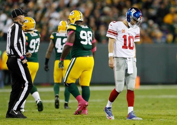 Giants quarterback Eli Manning walks off the field