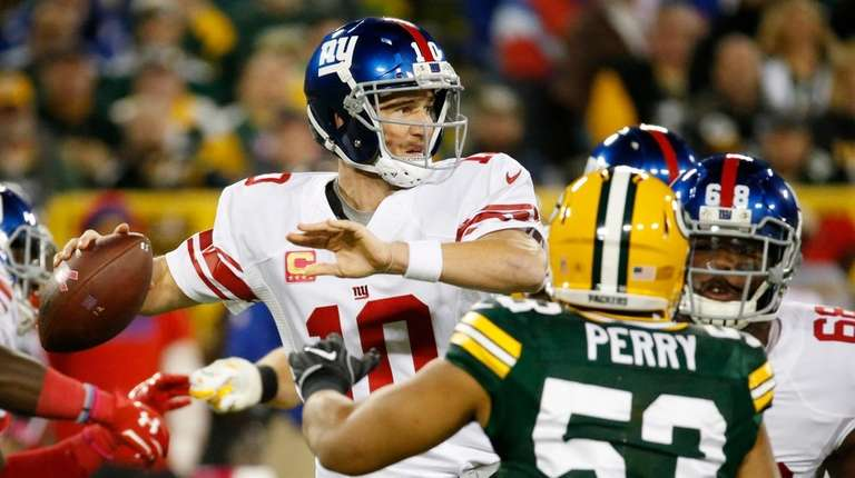 New York Giants' Eli Manning drops back to