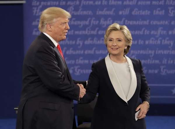 Republican presidential nominee Donald Trump shakes hands with