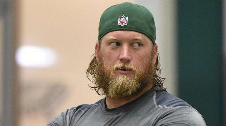New York Jets center Nick Mangold speaks with