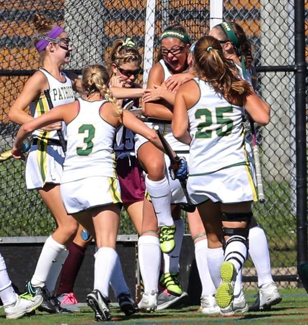 Ward Melville celebrates the game-winning goal by Lexi