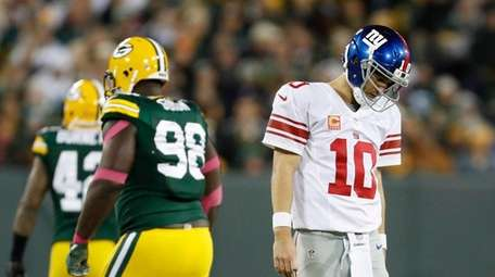 New York Giants' Eli Manning walks off the
