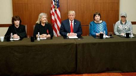 Donald Trump with, from left, Kathleen Willey, Juanita