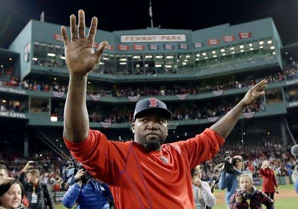 Boston Red Sox's David Ortiz waves from the