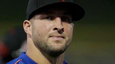 Former NFL quarterback Tim Tebow gets ready for