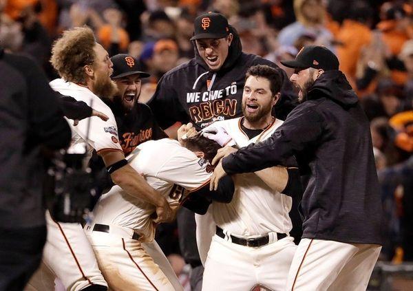 San Francisco Giants' Joe Panik, center bottom, is
