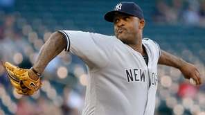 Yankees starting pitcher CC Sabathia delivers to the