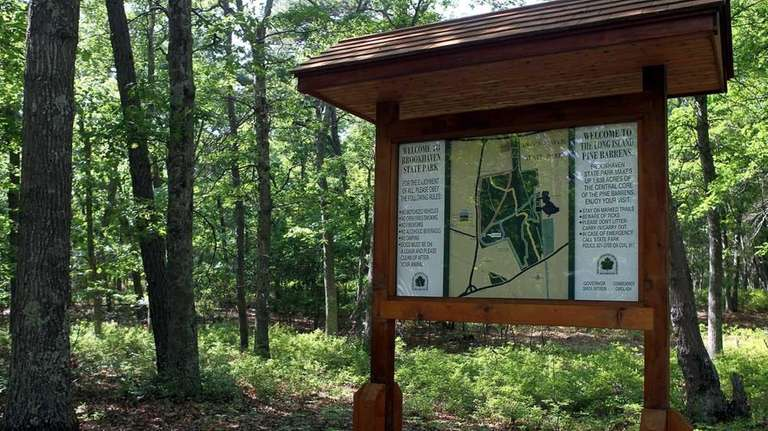 A welcome sign highlights hiking trails for visitors