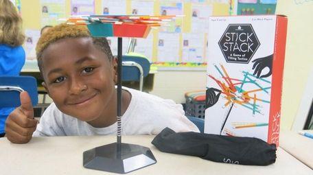 Kidsday reporter Malachi Robinson tests the Stick Stack