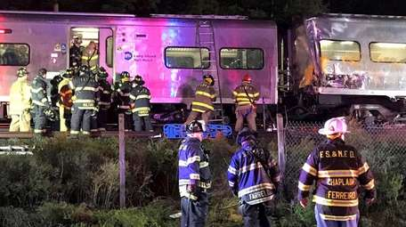 Police and firefighters respond to a LIRR train