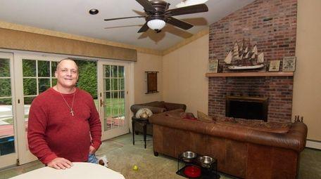 James Heisser-Stevenson in the family room of his