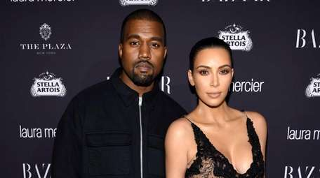 Kanye West and Kim Kardashian West attend a
