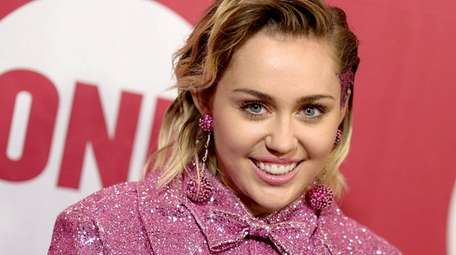 Miley Cyrus attends a fundraiser on Dec. 1,