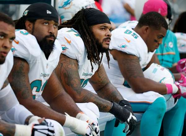 Miami Dolphins guard Billy Turner (77), center, offensive