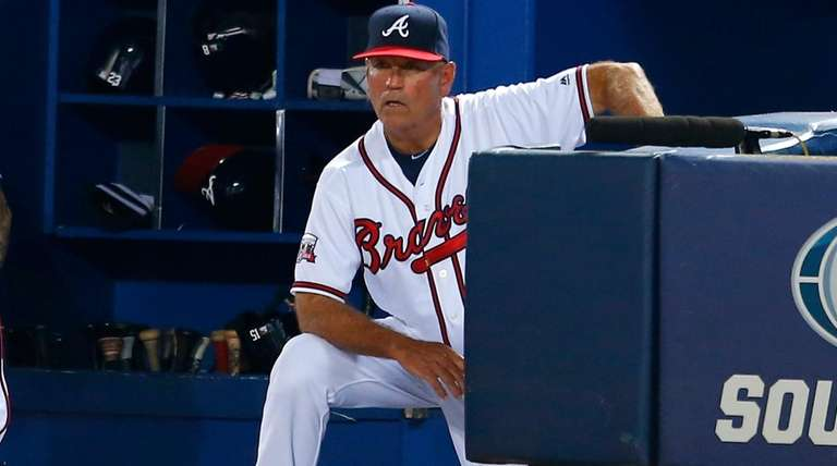 Atlanta Braves manager Brian Snitker  watches in the