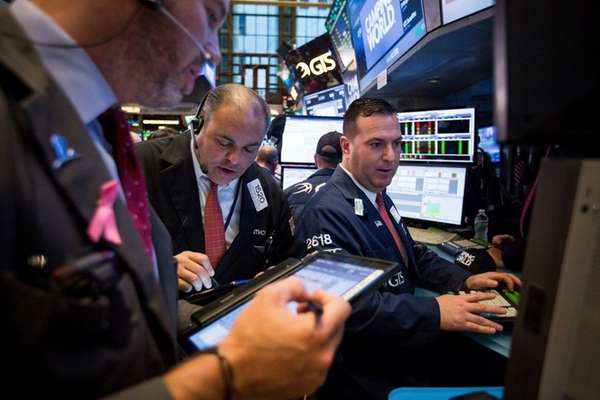 Traders on the New York Stock Exchange on
