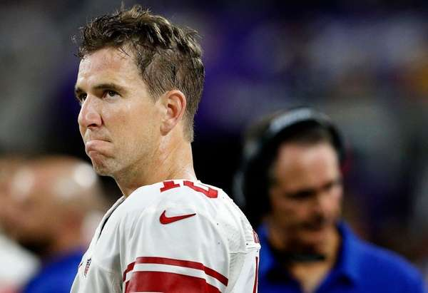 New York Giants quarterback Eli Manning watches form