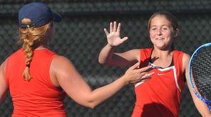Hailey Stoerback, right, and doubles partner Olivia Faulhaber