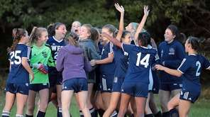 Smithtown West's girls soccer team celebrates their 1-0