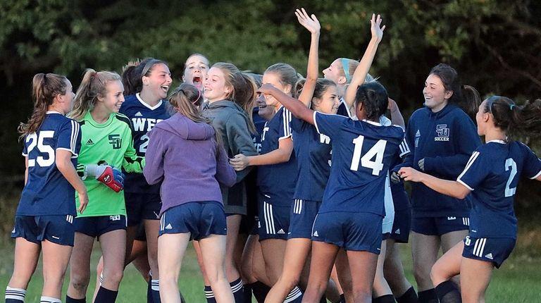Smithtown West's girls soccer team celebrates their 1-0