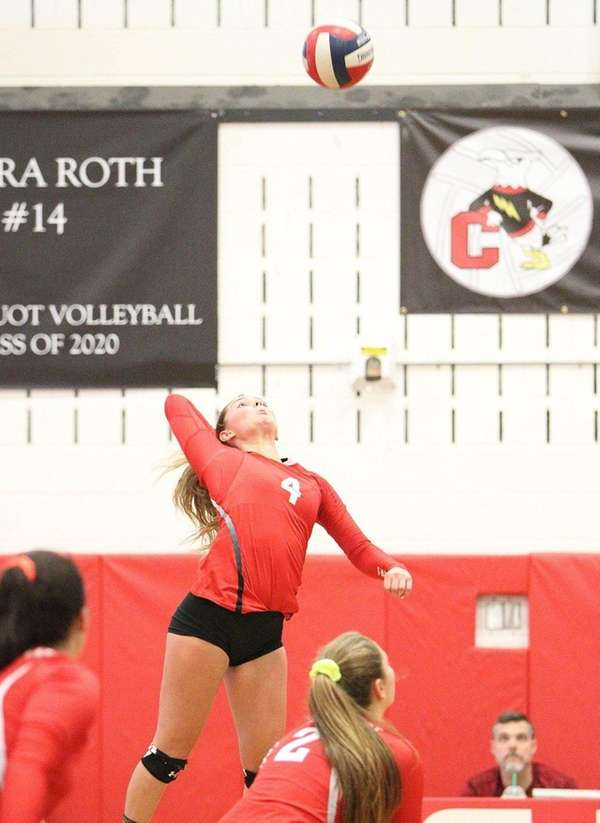 Connetquot's Mackenzie Taylor (4) serves the ball during