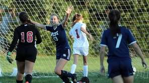 Smithtown West's Sarah Harrington raises arms in triumph