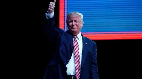 Republican presidential candidate Donald Trump gives a thumbs