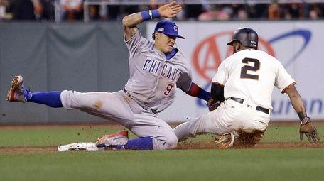 Chicago Cubs' second baseman Javier Baez (9) tags