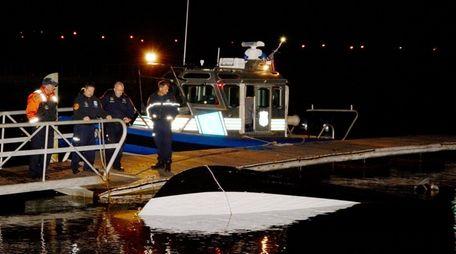 A Suffolk police marine bureau team looks at