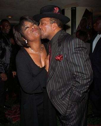 Talk show host Oprah Winfrey receives a kiss