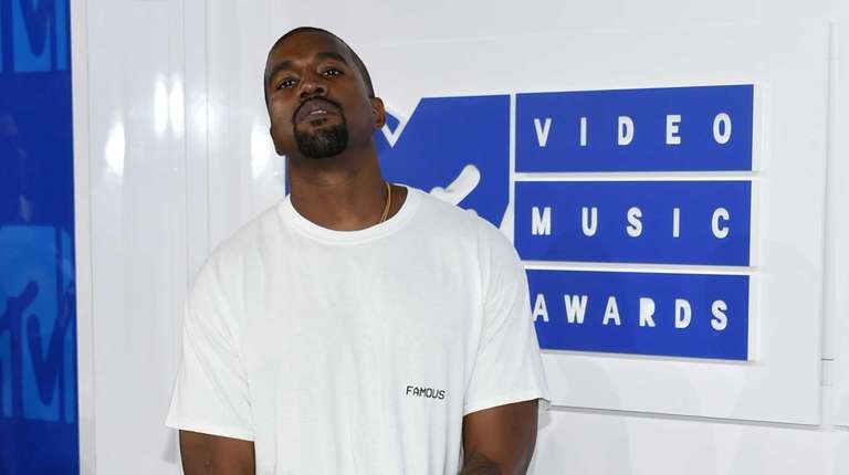 Kanye West posing at the MTV Video Music
