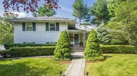 There's an open house for this three-bedroom, three-bath