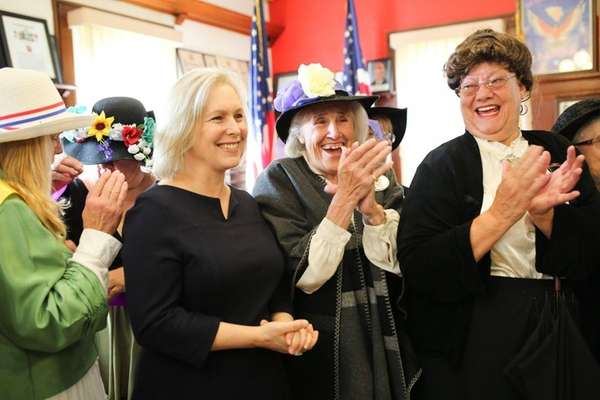 From left, Senator Kirsten Gillibrand applauds with Nancy