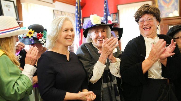 From left, Senator Kirsten Gillibrand applauds with Nancy