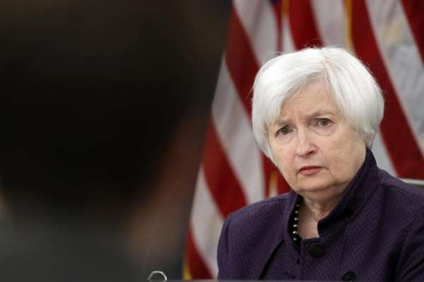 Federal Reserve Board Chair Janet Yellen listens to