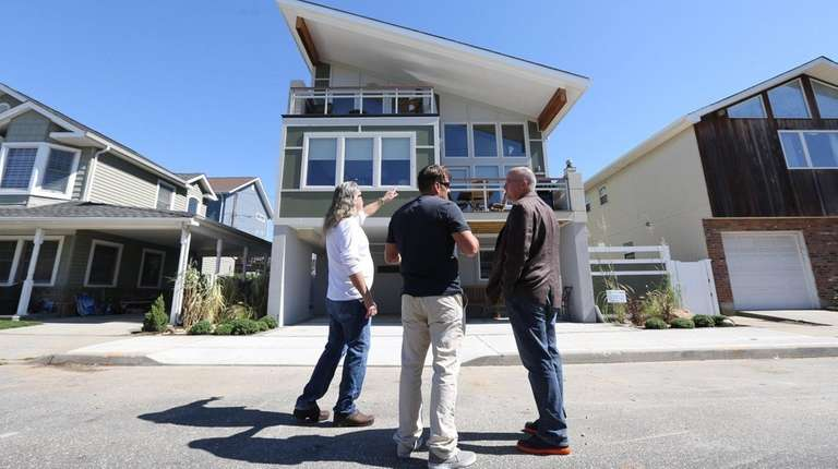 Homeowner Matthew Dwyer, left, construction manager Eric Daly,
