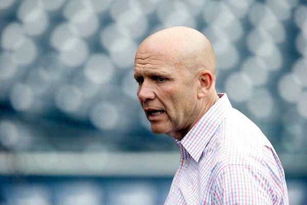 San Diego Padres president Mike Dee walks on