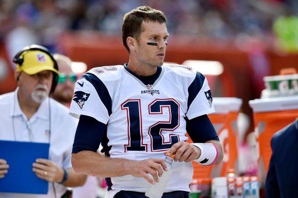 New England Patriots quarterback Tom Brady watches from