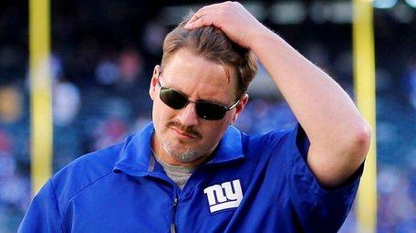 Giants' head coach Ben McAdoo walks off the